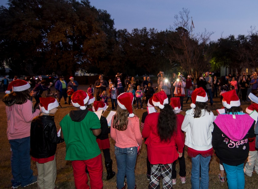 Children from the Joint Base Charleston Youth Center sing Christmas carols during the annual tree lighting ceremony Dec. 4, 2014, on Joint Base Charleston - Weapons Station, S.C. The tree lighting is an annual tradition held at both the Air Base and Weapons Station to kick off the holiday season. (U.S. Air Force photo/Senior Airman Melissa Goslin)