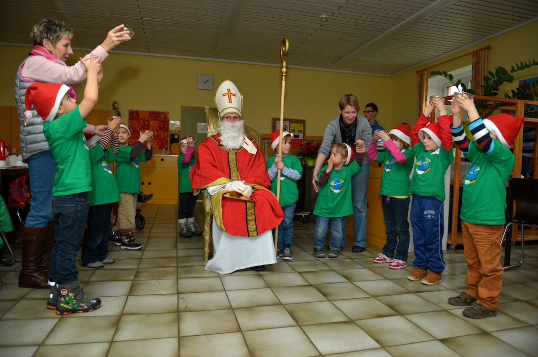 Children from St. Martin School in Bitburg, Germany, perform a skit for Sankt Nikolaus and visitors from Spangdahlem Air Base, Germany, Dec. 8, 2014. Nikolaus visited the school to meet with children and tell them Christmas stories. (U.S. Air Force photo by Airman 1st Class Kyle Gese/Released)