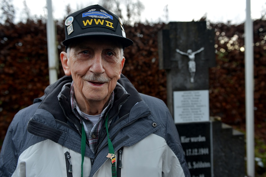 Victor Cross, World War II veteran, stands in front of the Wereth 11 memorial outside of Wereth, Belgium, Dec. 10, 2014. Cross revisited the site as part of the 70th Anniversary of the Battle of the Bulge. This battle is said to be the bloodiest battle in U.S. history with more than 20,000 U.S. Soldiers killed. (U.S. Air Force photo by Airman 1st Class Kyle Gese/Released)