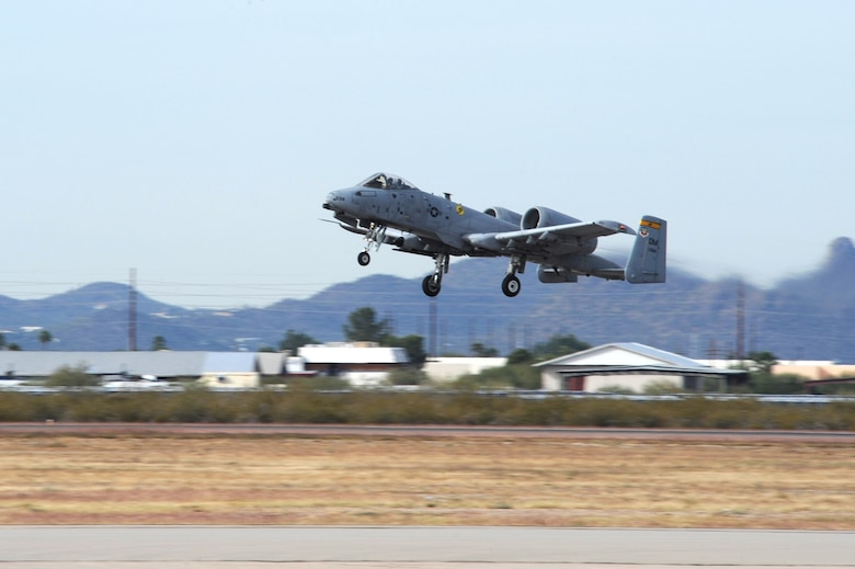 An A-10C Thunderbolt II takes to the sky for the first time after being grounded for two months at Davis-Monthan Air Force Base Ariz., Dec. 5, 2014. On Sept. 30, this aircraft came in for a routine landing, but the landing gear failed to extend. (U.S. Air Force photo by Staff Sgt. Courtney Richardson)