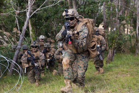 U.S Marine with Company E, Battalion Landing Team 2nd Battalion, 4th Marines, (BLT) 31st Marine Expeditionary Unit, moves towards targets while conducting a vertical assault at Combat Town, Okinawa, Japan, Dec. 8 Company E. is conducting training as part of the MEU Exercise and pre-deployment training.