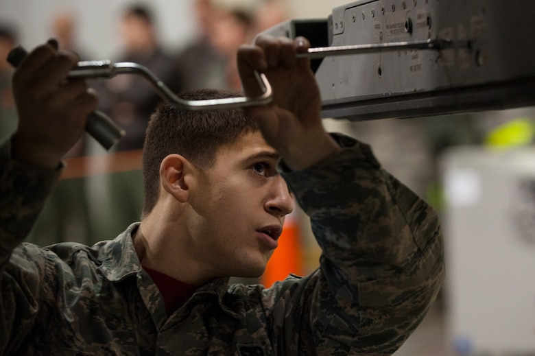 Senior Airman Chris Orsi competes in the Load Crew of the Year competition Dec. 5, 2014, at Eielson Air Force Base, Alaska. The competition pitted two load crews against each other to evaluate who could prepare the aircraft for combat the fastest and with the fewest procedural errors. Orsi is a weapons loader with the 18th Aircraft Maintenance Unit.  (U.S. Air Force photo/Tech. Sgt. Joseph Swafford)
