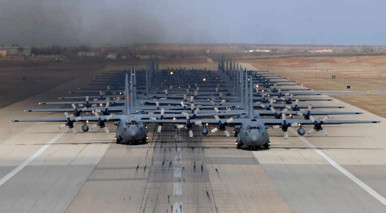 Eleven C-130H Hercules' and 13 C-130J Super Hercules' prepare to take off Dec. 6, 2014, from Dyess Air Force Base, Texas in support of the U.S. Air Force Weapons School's Joint Forcible Entry Exercise 14B. The C-130H models are from various Air National Guard units and the C-130J models are from the 317th Airlift Group at Dyess Air Force Base, Texas. In addition to the C-130s, the JFEX included approximately 20 C-17 Globemaster IIIs and various other aircraft. (U.S. Air Force photo/Airman 1st Class Alexander Guerrero)