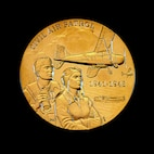 A close up of the Congressional Gold Medal presented by Speaker of the House of Representatives John Boehner to the Civil Air Patrol in honor of the World War II members during a ceremony Dec. 10, 2014 on Capitol Hill, Washington, D.C.  (U.S. Air Force/Andy Morataya)