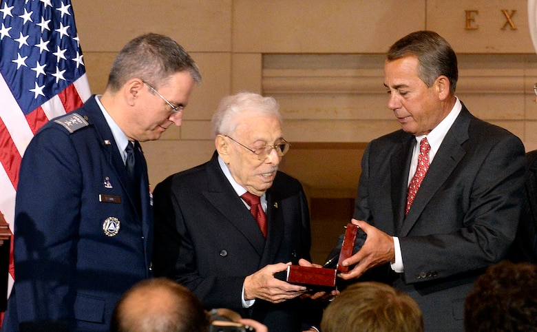 Civil Air Patrol National Commander Joseph Vazquez looks on as Speaker of the U.S. House of Representatives John Boehner presents the Congressional Gold Medal to Lester Wolff, a former member of Congress and Civil Air Patrol veteran, during a ceremony Dec. 10, 2014, on Capitol Hill, Washington, D.C.  Vazquez and Wolff accepted the medal on behalf of the CAP World War II members.  (U.S. Air Force/Andy Morataya)