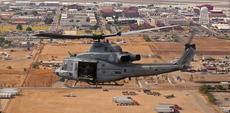 A UH-1Y Venom helicopter with Marine Light Attack Helicopter Squadron 267, based out of Marine Corps Base Camp Pendleton, Calif., flies overhead during a week-long deployment-for-training exercise conducted at Marine Corps Air Station Yuma, Ariz., Dec. 9, 2014.
