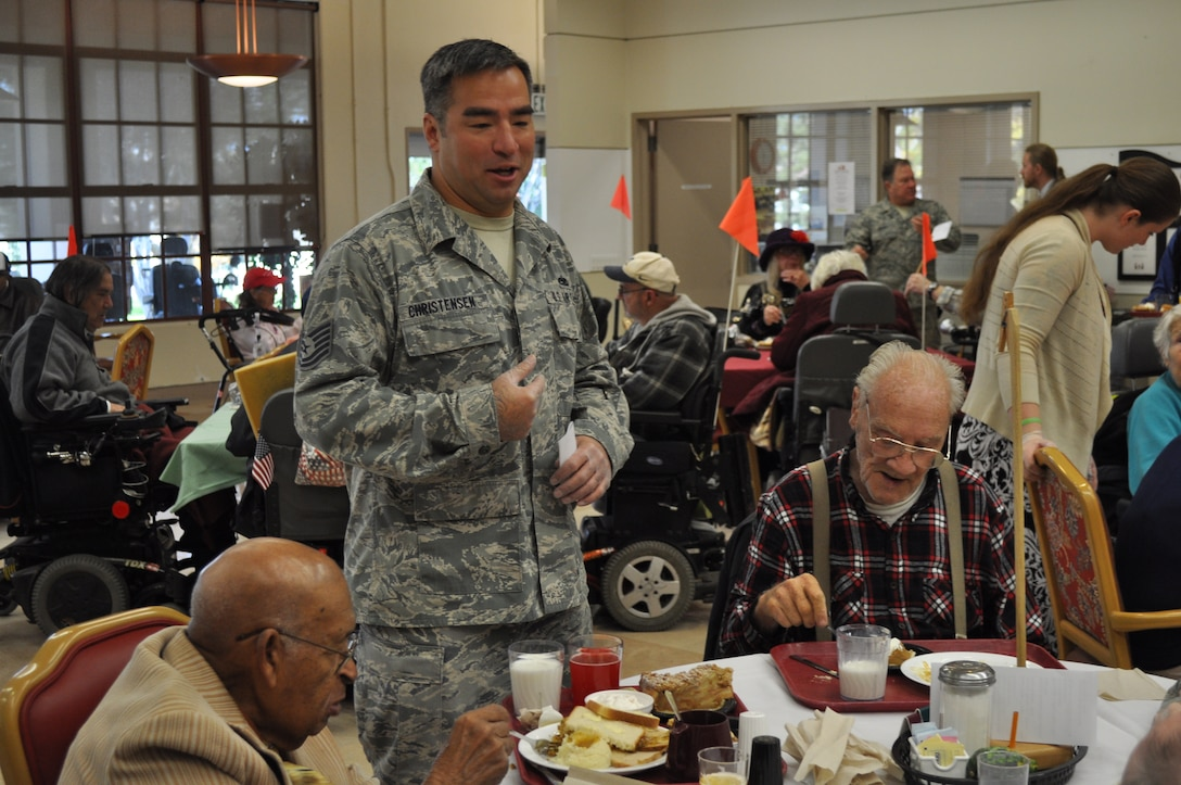 "TRAVIS AIR FORCE BASE, Calif. -- Airmen from the 349th Air Mobility Wing ""Give Thanks' by serving dinner to these veterans who have paved the way for the military we have today. Along with their friends and family, they share fellowship and a scrumptious turkey dinner with the men and women who, happily, shared their military stories and experiences. (U.S. Air Force photo / Ellen Hatfield)"