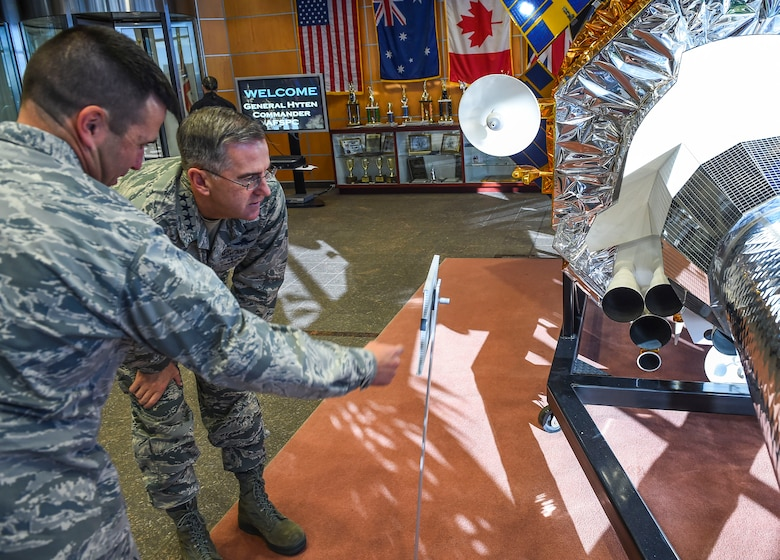 Col. John Wagner, 460th Space Wing commander, left, shows General John E. Hyten, Commander of Air Force Space Command, a satellite display model Dec. 10, 2014, in the 460th Operations Group Mission Control Station on Buckley Air Force Base, Colo. During General Hyten's first visit to Buckley after assuming AFSPC command Aug 2014, he received a mission brief, toured the mission control station and spoke with Airmen at a commander's call. AFSPC provides space and cyberspace capabilities for the joint force and the nation, and the 460th SW is one of several units in Colorado and around the world that supports AFSPC's mission. (U.S. Air Force photo by Senior Airman Riley Johnson/Released)