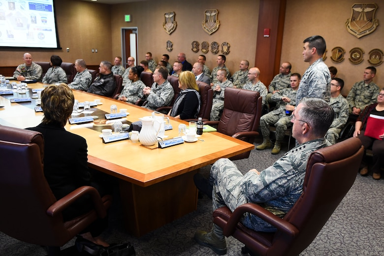 Col. John Wagner, 460th Space Wing commander, standing, provides General John E. Hyten, Commander of Air Force Space Command, the 460th SW mission brief Dec. 10, 2014, in the 460th SW conference room on Buckley Air Force Base, Colo. During General Hyten's first visit to Buckley after assuming AFSPC command Aug 2014, he received a mission brief, toured the 460th Operations Group Mission Control Station and spoke with Airmen at a commander's call. AFSPC provides space and cyberspace capabilities for the joint force and the nation, and the 460th SW is one of several units in Colorado and around the world that supports AFSPC's mission. (U.S. Air Force photo by Senior Airman Riley Johnson/Released)