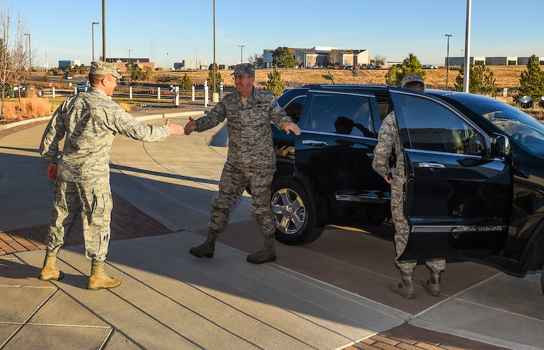 Col. John Wagner, 460th Space Wing commander, left, greets General John E. Hyten, Commander of Air Force Space Command, Dec. 10, 2014, in front of the 460th SW headquarters on Buckley Air Force Base, Colo. During General Hyten's first visit to Buckley after assuming AFSPC command Aug 2014, he received a mission briefing, toured the 460th Operations Group Mission Control Station and spoke with Airmen at a commander's call. AFSPC provides space and cyberspace capabilities for the joint force and the nation, and the 460th SW is one of several units in Colorado and around the world that supports AFSPC's mission. (U.S. Air Force photo by Senior Airman Riley Johnson/Released)