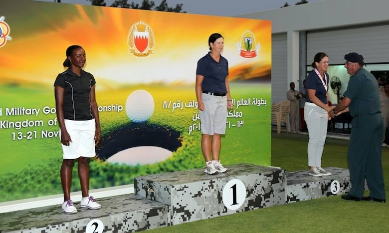 USAF Maj. Linda Jeffery (center) and Navy LT Nicole Johnson (receiving her medal) win gold and bronze respectively. The US Men and Women Armed Forces Golf teams won respective gold medals for the seventh time during the 8th CISM World Military Golf Championship held in Bahrain 13-21 November 2014.