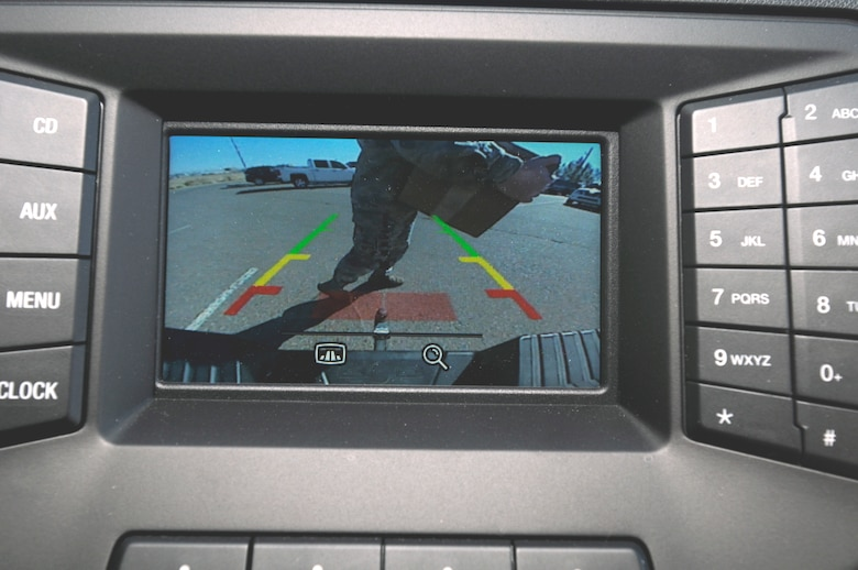 The driver's view of the image from a backup camera when there's an object or person behind the vehicle. (U.S. Air Force photo by Keith Wright)