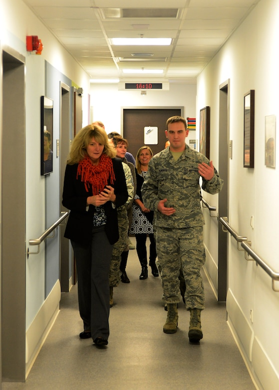 Cheryl Roberson, wife of U.S. Air Force Lt. Gen. Darryl Roberson, 3rd Air Force and 17th Expeditionary Air Force commander, and U.S. Air Force Airman 1st Class James Roberts, 52nd Medical Operations Squadron aerospace medical technician, tour the base clinic at Spangdahlem Air Base, Germany, Dec. 9, 2014. Roberts and other 52nd MDOS Airmen updated Roberson on the new technologies and resources the facility provides to Spangdahlem. (U.S. Air Force photo by Airman 1st Class Luke Kitterman/Released)