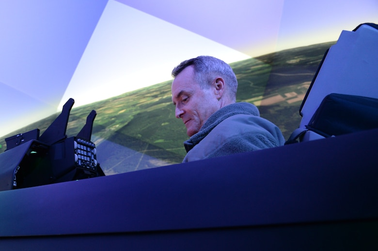 U.S. Air Force Lt. Gen. Darryl Roberson, 3rd Air Force and 17th Expeditionary Air Force commander, operates an F-16 Fighting Falcon fighter aircraft flight simulator during an immersion visit Dec. 9, 2014, to Spangdahlem Air Base, Germany. Roberson, a previous wing commander at Spangdahlem from 2006-2008, toured new the facilities that were not here during his command. (U.S. Air Force photo by Airman 1st Class Dylan Nuckolls/Released)