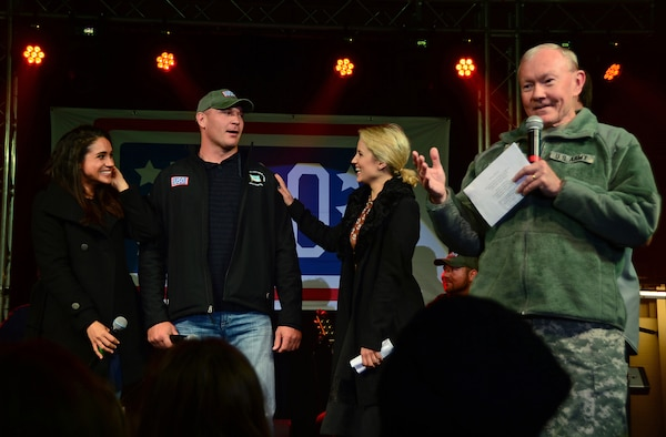 Army Gen. Martin E. Dempsey, right, chairman of the Joint Chiefs of Staff, speaks during the USO's holiday show at Royal Air Force Mildenhall, England, Dec. 10, 2014. U.S. Air Force photo by Senior Airman Erin O'Shea