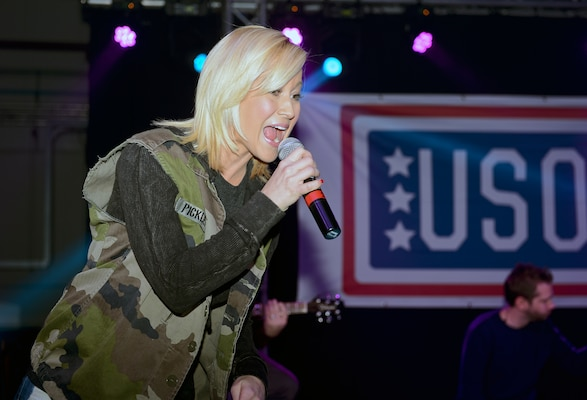 Country music artist Kellie Pickler sings for airmen during the USO's holiday show at Royal Air Force Mildenhall, England, Dec. 10, 2014. The USO show visited five countries to perform for thousands of service members and their families. U.S. Air Force photo by Airman 1st Class Trevor T. McBride
