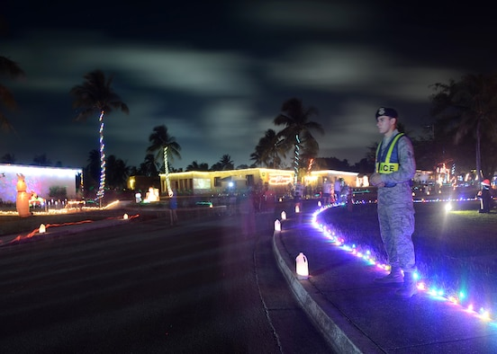 Airman 1st Class Jon Simotas, 36th Security Forces Squadron, helps ensure the safety of several hundred pedestrians participating in the annual Rota Walk Dec. 13, 2014, at Andersen Air Force Base, Guam. More than 300 military members and civilians attended the event which is held every December. (U.S. Air Force photo by Tech. Sgt. Zachary Wilson/Released)