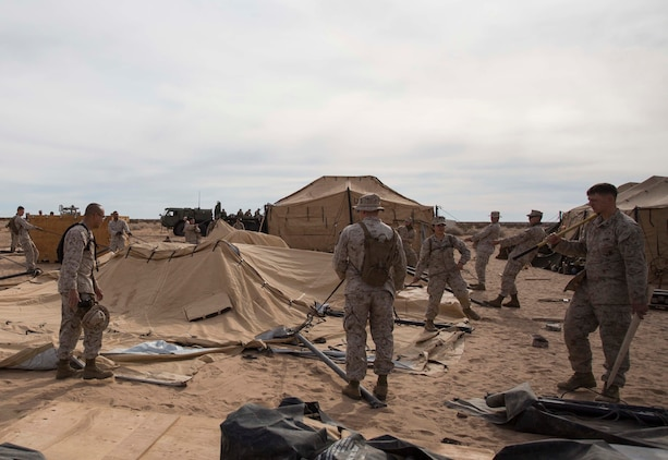 Marines with Marine Wing Support Squadron 371 build sleeping posts during the security force exercise in support of pre-deployment training Dec. 7-10, 2014, at the Auxiliary Landing Field II on Marine Corps Air Station Yuma, Ariz. (U.S. Marine Corps photo by Cpl. Reba James/Released)