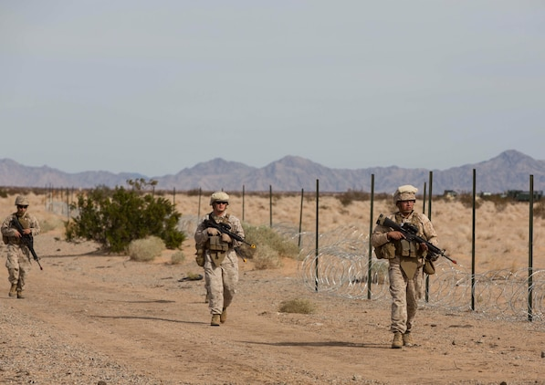 Marines with Marine Wing Support Squadron 371 complete a foot patrol during the security force exercise in support of pre-deployment training Dec. 7-10, 2014, at the Auxiliary Landing Field II on Marine Corps Air Station Yuma, Ariz. (U.S. Marine Corps photo by Cpl. Reba James/ Released)