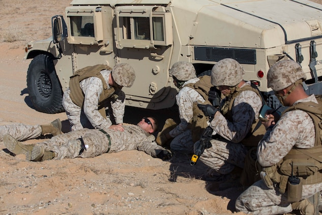 Marines with Marine Wing Support Squadron 371 perform casualty care while on patrol during the security force exercise in support of pre-deployment training Dec. 7-10, 2014, at the Auxiliary Landing Field II on Marine Corps Air Station Yuma, Ariz. As a part of the exercise, Marines called in a 9-line casualty evacuation as if they were deployed, in order to get the casualty to safety. (U.S. Marine Corps photo by Cpl. Reba James/ Released)