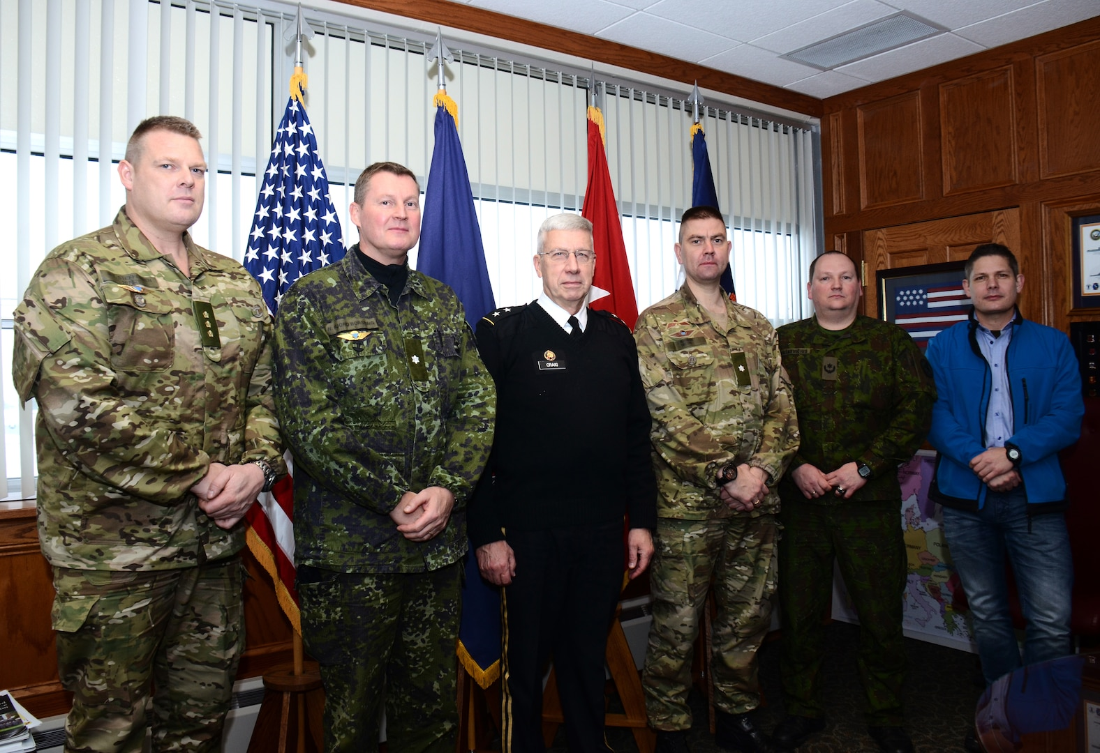 Personnel from the Danish Division meet with Pennsylvania Adjutant General Maj. Gen. Wesley Craig during a visit to Fort Indiantown Gap, Pennsylvania., Dec. 11, 2014. The Danish Division is on a seven-day collaborative planning visit to Pennsylvania to prepare for Saber Strike 2015 with the 28th Infantry Division, Pennsylvania Army National Guard.