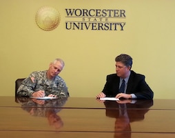 Col. Christopher Barron, New England District Commander, signs a STEM partnership agreement with Worcester State University's president, Barry Maloney, Oct. 27, 2014.