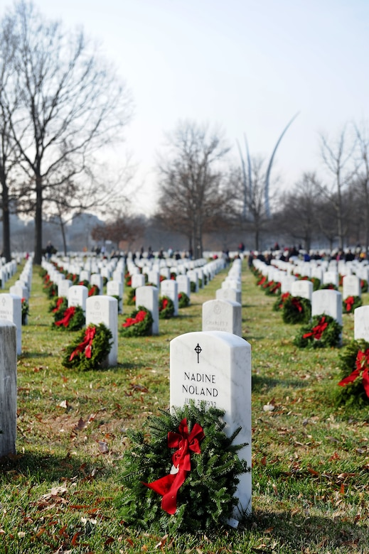 Wreaths lay amongst tombstones during the 23rd Annual National Wreaths Across America Day Dec. 13, 2014, at Arlington National Cemetery, Virginia. Airmen from all around the Washington D.C. area, along with friends and families of fallen warriors were among the nearly 50,000 volunteers to place remembrance wreaths on the headstones of about 230,000 veterans. (U.S. Air Force photo/Staff Sgt. Christopher Gross)