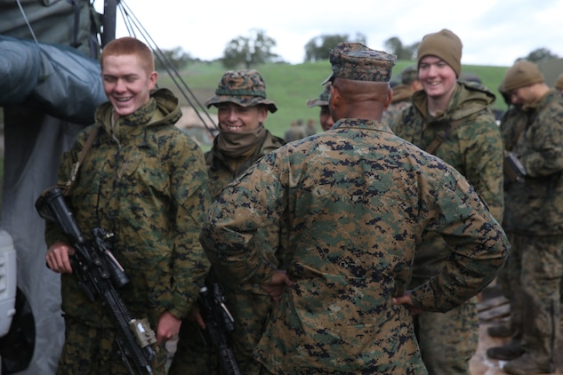 U.S. Navy Commander Samuel Ravelo visits U.S. Marines with Headquarters and Service Company, Battalion Landing Team 3rd Battalion, 1st Marine Regiment, during realistic urban training aboard Camp Roberts, Calif., Dec. 12, 2014. Ravelo is the chaplain of the 15th Marine Expeditionary Unit. The purpose of RUT is to provide the MEU the opportunity to conduct training in unfamiliar environments in preparation for their upcoming deployment. (U.S. Marine Corps photo by Cpl. Anna Albrecht/ Released)