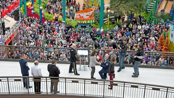 First Sgt. Robert Renning of 133rd Airlift Wing was able to give a surprise proposal to his longtime girlfriend during the Mall of America's Holiday for Heroes, Dec 14, 2014.  Renning is the Wing's Outstanding First Sergeant of 2014 and became famous this summer for his life saving efforts of recusing a man from a burning vehicle.  (U.S. Air National Guard Photo by Tech. Sgt. Lynette Olivares / Released)