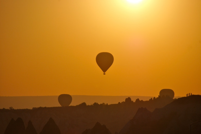 The traditional hot air balloons allow visitors to experience a view of Cappadocia, Turkey, primarily from April through October, when weather is favorable. Travel enables people to experience different cultures firsthand that may vary from the one they are accustomed to. (Curtesy photo by Jason Branch)