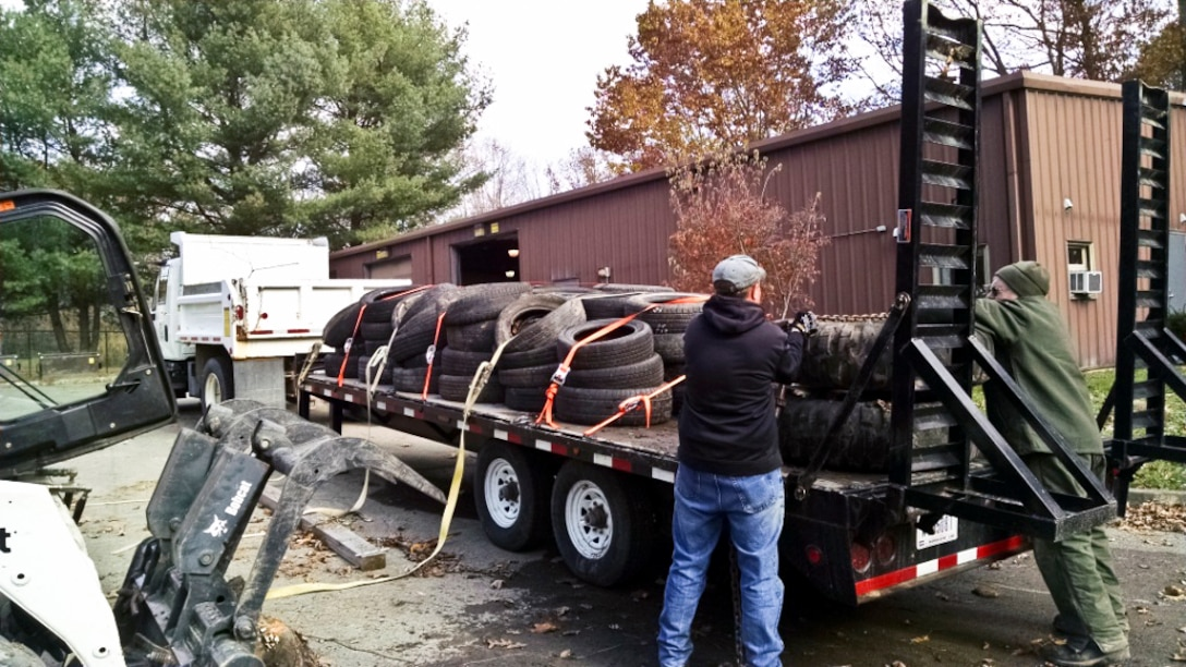 Maintenance Worker Brian Serafin and Lead Ranger Rich Egger prepare a load of tires for recycling.