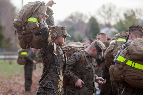 The Marines and Sailors of the Chemical Biological Incident Response Force, II Marine Expeditionary Force conduct a 9-mile conditioning hike on December 12 aboard Naval Support Facility Indian Head. (Official Marine Corps Photo by Sgt. Kuande L. Hall/RELEASED).