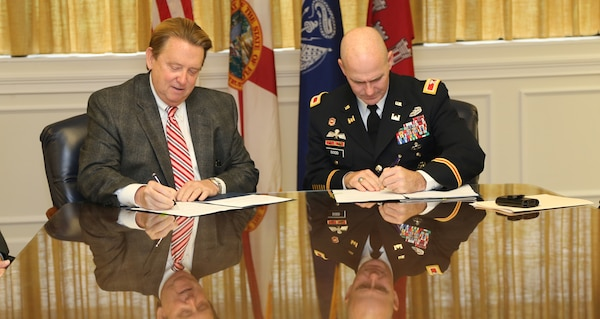 University of North Florida (UNF) President John A. Delaney (left) and Col. Alan M. Dodd (right), Commander, Jacksonville District, U.S. Army Corps of Engineers signed a Memorandum of Understanding on November 25, 2014, in order to advance educational opportunities between the Corps and UNF in STEM subject areas – math, science, engineering and technology – for developing student scientists and engineers.