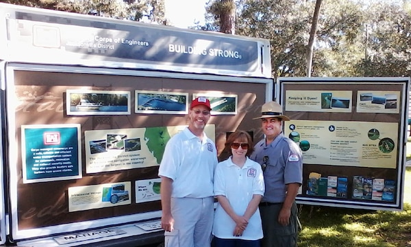 Corps water safety volunteers Michael and Terri Young and park ranger Brian Scott Older used the Corps interpretive multi-use trailer to teach members of the community about water safety and other Corps missions at Kiwanis Kids Day in LaBelle.