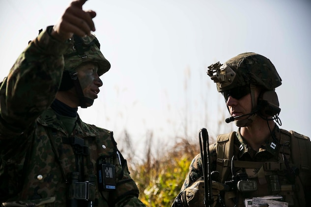 Japan Ground Self-Defense Force Maj. Tomohito Urakawa, left, speaks with U.S. Marine Capt. Stephen L. Walker Dec. 9 during Forest Light 15-1 at the Oyanohara Training Area in Yamato, Kumamoto prefecture, Japan. Forest Light is a routine, semi-annual exercise designed to enhance the U.S. and Japan military partnership, solidify regional security agreements and improve individual and unit-level skills. Urakawa is the company commander of 3rd Company, 42nd Regiment, 8th Division, Western Army, JGSDF. Walker, from Morganton, North Carolina, is a field artillery officer with 5th Air Naval Gunfire Liaison Company, III Marine Expeditionary Force Headquarters Group, III MEF.