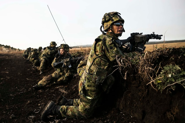 Japan Ground Self-Defense Force members engage in a simulated firefight Dec. 9 during Forest Light 15-1 at the Oyanohara Training Area in Yamato, Kumamoto prefecture, Japan. Forest Light is a routine, semi-annual exercise designed to enhance the U.S. and Japan military partnership, solidify regional security agreements and improve individual and unit-level skills. The JGSDF members are with 42nd Regiment, 8th Division, Western Army.