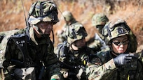 YAMATO,Japan (Dec. 9, 2014) - Japan Ground Self-Defense Force members discuss a plan of attack during Forest Light 15-1 at the Oyanohara Training Area.  Forest Light is a routine, semi-annual exercise designed to enhance the U.S. and Japan military partnership, solidify regional security agreements and improve individual and unit-level skills. The JGSDF members are with 42nd Regiment, 8th Division, Western Army.   141209-M-GX711-108