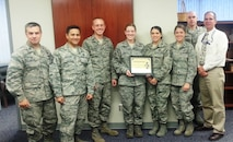 """PETERSON AIR FORCE BASE, Colo. -- Members of the Pikes Peak Top 3 present the October 2014 Sharp Warrior Award to Tech. Sgt. Jaclyn Cravens, 721st Mission Support Group. Cravens leads a 20-member Wing Readiness Inspection Team for Cheyenne Mountain Air Force Station, responsible for the planning, organization and evaluation of readiness factors. As the 721st MSG safety representative, she prepared the installation for a Wing evaluation, mentored unit monitors and led the mission support group to an """"Excellent"""" rating. Additionally, she planned and organized all readiness scenarios for Exercise Vigilant Shield 2015. Cravens has consistently demonstrated exceptional dedication and proficiency in her duties, and professionalism on and off duty, leading to her selection as the Sharp Warrior. (U.S. Air Force photo)"""