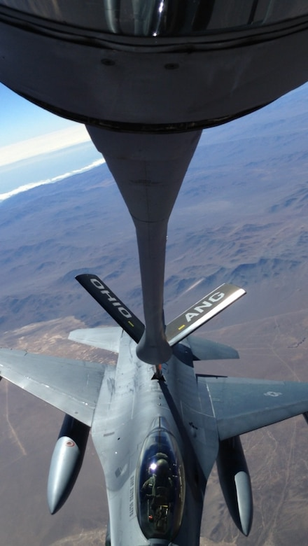 A 121st Air Refueling Wing KC-135 Stratotanker refuels an F-16 Fighting Falcon from the 149th Fighter Wing recently over Chile. The aircraft were taking part in Exercise Salitre. (Photo submitted/Released)