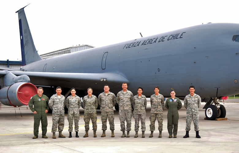 121st Air Refueling Wing Airmen pose with members of the Chilean Air Force in front of a Chilean KC-135 Stratotanker Oct. 5, 2014,  at Pudahuel Air Base, Chile. (Photo Submitted)