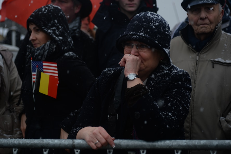 Jocelyne Gillis of Saint-Léger, Belgium, cries at the arrival of surviving World War II veterans before a ceremony in Bastogne, Belgium, Dec. 13, 2014. The veterans served during the Battle of the Bulge, a six-week campaign that liberated the city and signaled the coming surrender of Axis forces during the war. (U.S. Air Force photo by Staff Sgt. Joe W. McFadden/Released)