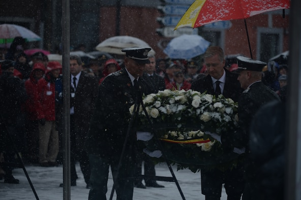 Belgian King Philippe lays a wreath aided by Belgian Army soldiers at the statue of U.S. Army Brig. Gen. Anthony McAuliffe, during a ceremony in Bastogne, Belgium, Dec. 13, 2014. More than 40,000 American and European citizens honored the service and legacy of more than 40 surviving World War II veterans as part of a 70th anniversary celebration of the Battle of the Bulge. (U.S. Air Force photo by Staff Sgt. Joe W. McFadden/Released)