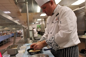 Army Sgt. Andrew Shurden prepares a potato dish during tryouts for the culinary arts team at Joint Base Lewis-McChord, Wash., Nov. 21, 2014. Soldiers selected for the team will compete in the Military Culinary Arts Training Event at Fort Lee, Va. U.S. Army photo by Sgt. James J. Bunn