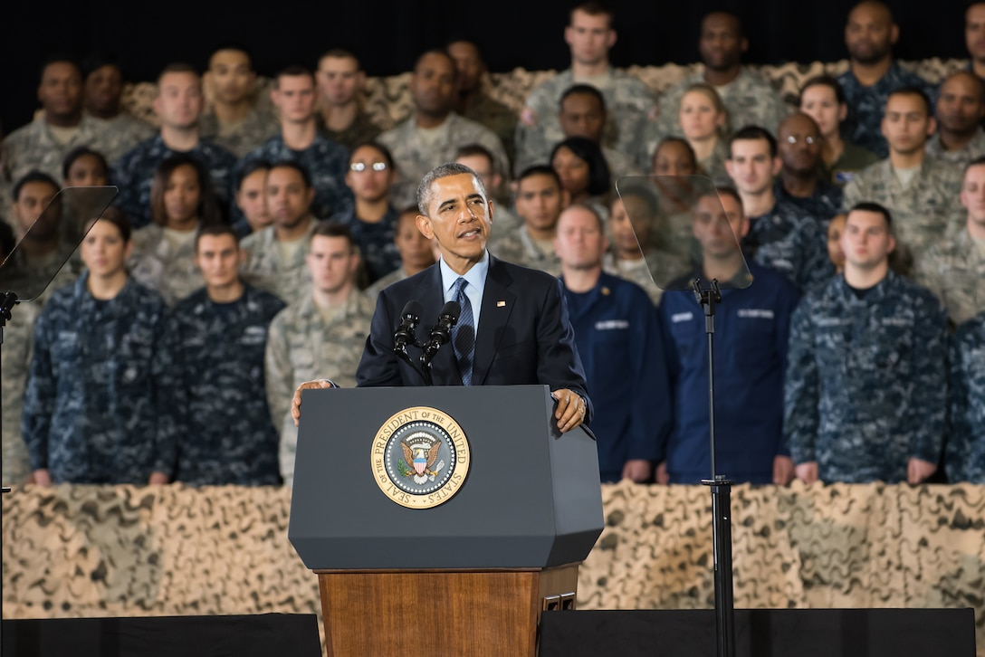 President Barack Obama addresses a crowd of service members and Defense Department civilians Dec. 15, 2014, at Joint Base McGuire-Dix-Lakehurst, N.J. The event allowed more than 3,000 military and civilian personnel to listen to their commander in chief discuss current conflicts and mission readiness, but more importantly thank the attendees for their service and dedication to their nation. (U.S. Air Force photo/Russ Meseroll)