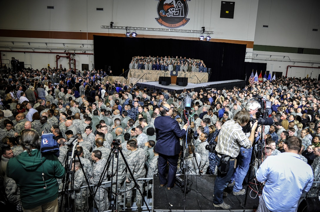 President Barack Obama addresses a crowd of service members and Defense Department civilians Dec. 15, 2014, at Joint Base McGuire-Dix-Lakehurst, N.J. The event allowed more than 3,000 military and civilian personnel to listen to their commander in chief discuss current conflicts and mission readiness, but more importantly thank the attendees for their service and dedication to their nation. (U.S. Air Force photo/Staff Sgt. Scott Saldukas)