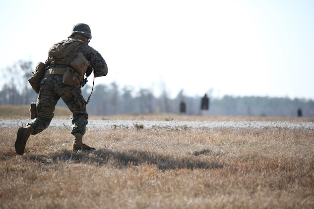 Cpl. Ramses Chavez, rifleman, Company A, Ground Combat Element Integrated Task Force, conducts a movement under simulated fire during a fire team collective skills exercise at Range K509, Marine Corps Base Camp Lejeune, North Carolina, Dec. 16, 2014. The assault served as the company's first collective skills-level exercise. From October 2014 to July 2015, the Ground Combat Element Integrated Task Force will conduct individual and collective skills training in designated combat arms occupational specialties in order to facilitate the standards based assessment of the physical performance of Marines in a simulated operating environment performing specific ground combat arms tasks. (U.S. Marine Corps photo by Cpl. Paul S. Martinez/Released)