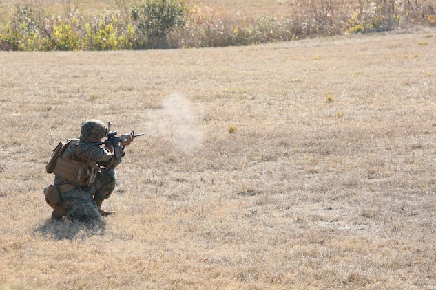 Sgt. Kyle Stubbeman, fire team leader, Company A, Ground Combat Element Integrated Task Force,  executes an assault on a simulated enemy position during a fire team collective skills exercise at Range K509, Marine Corps Base Camp Lejeune, North Carolina, Dec. 16, 2014. The Marines utilized the M4 carbine rifle and M16-A4 service rifle, as well as the M27 Infantry Automatic Rifle and M203 grenade launcher. From October 2014 to July 2015, the Ground Combat Element Integrated Task Force will conduct individual and collective skills training in designated combat arms occupational specialties in order to facilitate the standards based assessment of the physical performance of Marines in a simulated operating environment performing specific ground combat arms tasks. (U.S. Marine Corps photo by Cpl. Paul S. Martinez/Released)