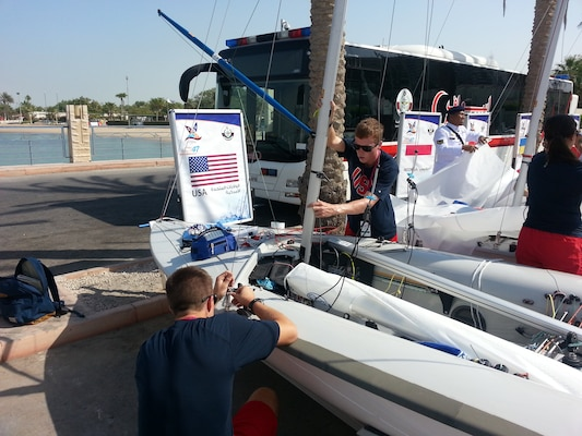 Men's skipper Coast Guard Lt. j.g. Samuel Ingham of Naval Air Station Pensacola, Fla. and Coast Guard Lt. j.g. Sean Kelly of San Francisco Sector, Calif. prepare their vessel prior to the 47th CISM World Military Sailing Championship held in Doha, Qatar Nov. 22-29, 2015.