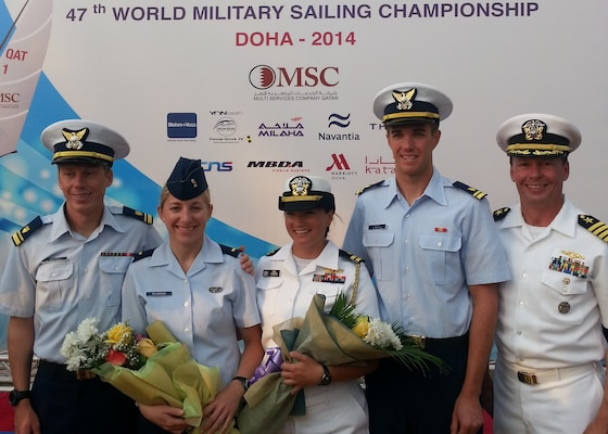 Team USA from left to right: Men's skipper Coast Guard Lt. j.g. Samuel Ingham of Naval Air Station Pensacola, Fla., Air Force 2nd lt. Keisha Pearson of Joint Base Langley-Eustis, Va., Women's skipper Navy Lt. Trisha Kutkiewicz of Washington, D.C., Coast Guard Lt. j.g. Sean Kelly of San Francisco Sector, Calif. and Chief of Mission Navy Capt. Eric Irwin of Newport, R.I. The 47th CISM World Military Sailing Championship was held in Doha, Qatar Nov. 22-29, 2015.