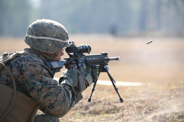 Lance Cpl. Jose Damoeda, rifleman, Company A, Ground Combat Element Integrated Task Force, fires an M27 Infantry Automatic Rifle during a fire team collective skills exercise at Range K509, Marine Corps Base Camp Lejeune, North Carolina,  Dec. 16, 2014. The assault served as the company's first collective skills-level exercise. From October 2014 to July 2015, the Ground Combat Element Integrated Task Force will conduct individual and collective skills training in designated combat arms occupational specialties in order to facilitate the standards based assessment of the physical performance of Marines in a simulated operating environment performing specific ground combat arms tasks. (U.S. Marine Corps photo by Cpl. Paul S. Martinez/Released)